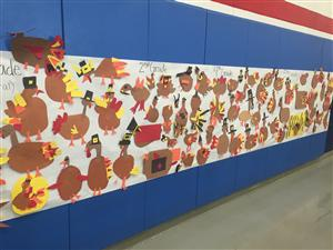 Elementary artwork adorns the walls of the cafeteria to welcome family members to lunch