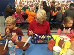 Mrs. Nuttal eating with her students